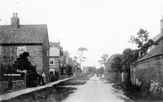 Old cottages on Albert Street, photographed in the early 1900s.