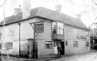 The Bull Hotel 1930 - Nancy Goodson and Herbert Goodson by the door. | Bottesford Local History Archive