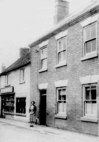 Mrs Samuel outside the store, circa1935. | Bottesford Local History Archive