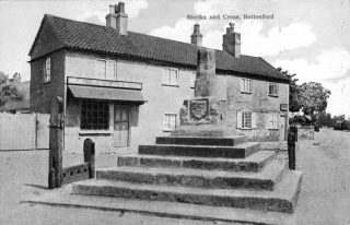Taylor's Butchers (left) and Sutton's Grocery (right) - an early 20th Century postcard. | Bottesford Local History Archive