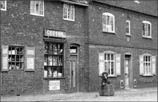 Arthur Cecil Geeson, seated outside Geeson's grocery shop, Church St., 1901. | Bottesford Local History Archive