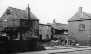 Clearance of the Chip Shop site in the 1960s; half-demolished cottages to the rear and the cowsheds behind No.5 can be seen. It also shows the barn before conversion to commercial premises. | Bottesford Local History Archive