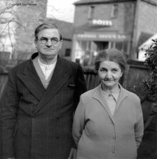 Mr and Mrs W.H. Greaves by their cycle shop on Queen St, 1960s. | Bottesford Local History Archive, ©Ted Rayson