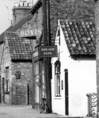William Miller's farm shop (later the Midland Bank) to the right of the malt house bakery. | Bottesford Local History Archive