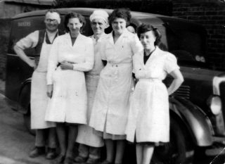 H. Simpson and Sons Bakers staff outside the bakery on Devon Lane, Bottesford in 1950 (Tom Simpson, Winifred Claricoats, Cecil Briggs, Kathleen Langton, Emily Rayson). | Bottesford Local History Archive