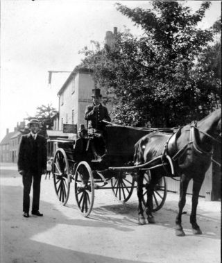 Singleton's horse and trap in Chapel Street, with the portico of Singleton's farmhouse glimpsed in the background. | Bottesford Local History Archive