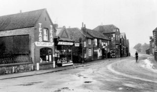 Standley's cafe and store, Hart's 'grocer and general dealer', and what became Ottley's shop, probably in the 1930s.                 | Bottesford Local History Archive