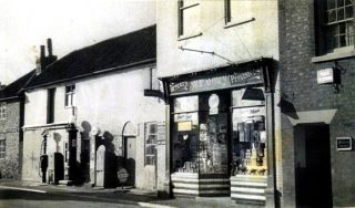 Hart's Garage (left), Ottley's shop (centre) and Mr Silkstone's dental surgery c1930s (extreme right). | Bottesford Local History Archive