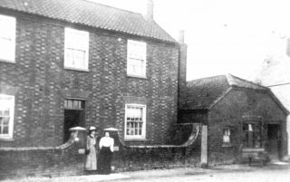 William Miller's farm and shop to the right in the early 1900s. | Bottesford Local History Archive