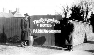 The Rutland Arms 'Parking Ground' in 1921, with Mr Terry (right) and friend. | Bottesford Local History Archive