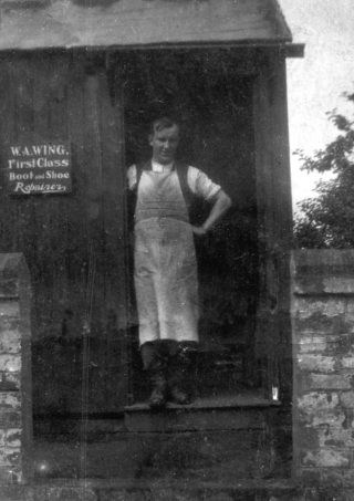 Arthur Wing's shoe repair workshop, which stood on land adjacent to the National Provincial Bank, c.1930. | Bottesford Local History Archive