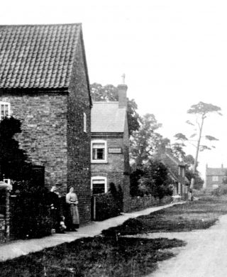 Cottages on Albert St, early 1900s - Sherwin's bakery sign can be seen on the second house.    | Bottesford Local History Archive