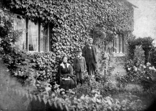 Mary and Victor Collett at The School House, Grantham Road, Bottesford in 1901 or soon after. The boy is probably their nephew William Barrand. | Bottesford Local History Archive