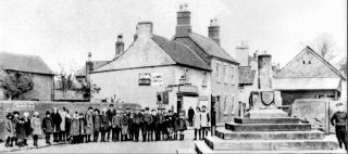 Bottesford school children at the village cross, 1920s. | Bottesford Local History Archive