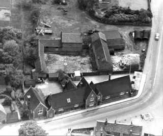 An aerial view of Bottesford School, ca.1960. The wartime air-raid shelter is the flat-roofed building at the right hand end of the school yard.                                                           | Bottesford Local History Archive