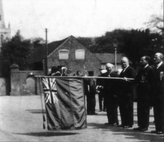 Lowering the flag, Armistice Day, 1930s. | Bottesford Local History Archive