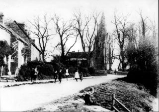 Village children in Main Street, ca.1900, St John's in the background. The cottages on the left, which housed several families, have been replaced by a single modern house.  | Bottesford Local History Archive