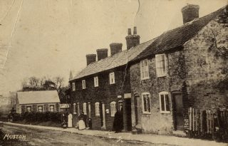 Post-Office Row' tenement cottages on Church Lane, Muston, circa1900; Methodist Chapel in the background.                                                                   | Bottesford Local History Archive