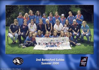 Bottesford Girl Guides celebrating the National 'Poacher' Camp, 2000, photographed by Steve Etherington.                                                                                                            | Bottesford Local History Archive