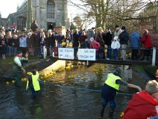 Finish of the Duck Race at the ford on Rectory Lane, Boxing Day 2008. | Bottesford Local History Archive