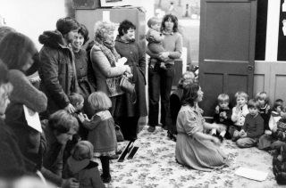 Irene Pacey leading the children's singing at the Playgroup Christmas Party, 1981. | Bottesford Local History Archive