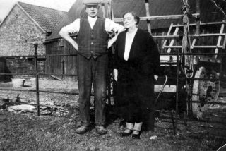 Herbert Daybell (senior) and his wife Flo' in the farmyard at Devon Farm, Bottesford. | Bottesford Local History Archive
