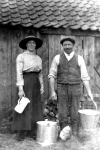Milking, at Palmer's farm. | Bottesford Local History Archive