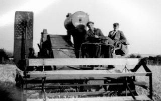 """""""Our first combine"""", bought for £1000 after the war: George Barratt (driving) and Ernie Hodson. 