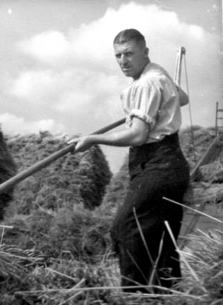 Hard at work, a Nottinghamshire miner helping with the harvest, 1947. | Bottesford Local History Archive