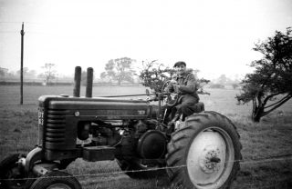 George Barratt driving the John Deere tractor purchased after the end of the war. | Bottesford Local History Archive
