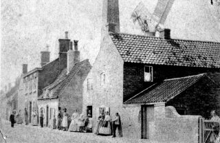 Queen Street mill, Bottesford, in the late 19th Century. Most of these buildings have gone,  and the windmill appears to have been taken down by the end of the 19th Century.   Bottesford Local History Archive