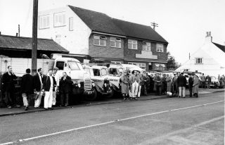 W.J. Roberts Ltd. workforce and vehicles outside the yard on High Street, 1960s. | Bottesford Local History Archive, Copyright Ted Rayson.