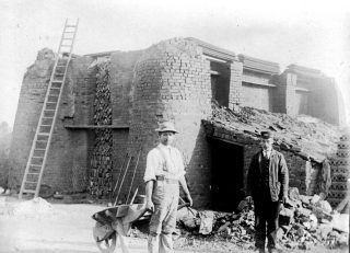 By the kiln at Challands' brickworks, ca.1900. The man on the right, in a GNR uniform, probably worked at Bottesford station. | Bottesford Local History Archive
