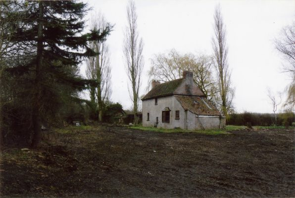 A view of the Lock House from the north, during removal of the grassy turf that had surrounded the building.