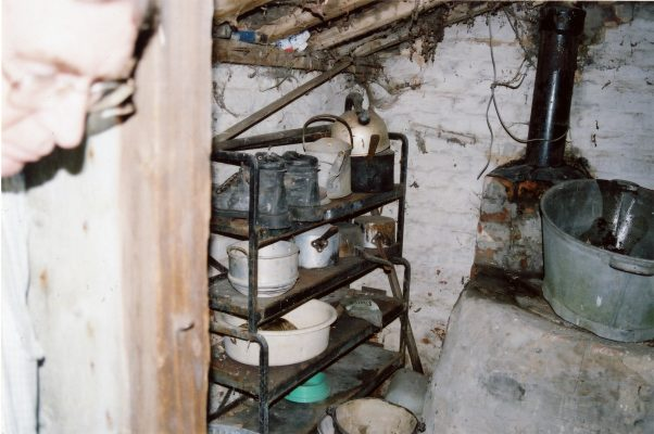 This is the interior of the small lean-to added beyond the kitchen. In the right-hand corner is the old water heater used for laundry.