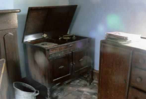 Probably a corner in the living room, an old gramophone and collection of 78s. | Margaret Langton