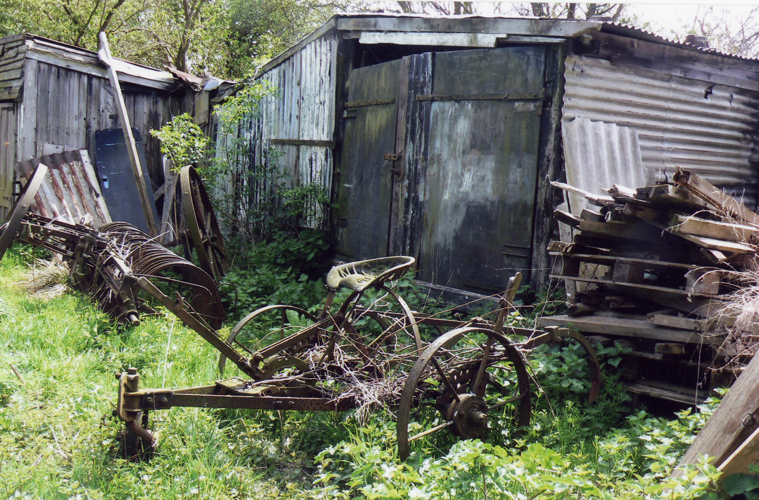 Abandoned farm machinery by the sheds at the Lock House