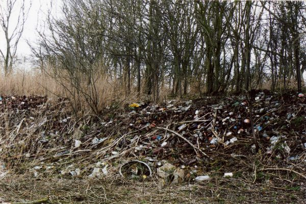 Old bottles, cans and other refuse were dumped on a slope at one end of the Lock House site.   Margaret Langton
