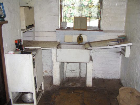 The kitchen, with its flagstone floor.   Neil Fortey