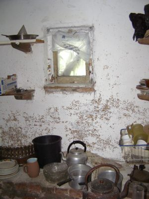 Store cupboard interior - pots and pans.   Neil Fortey