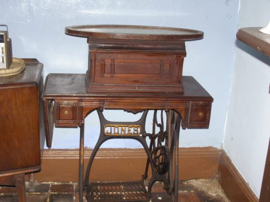 The 'spare' sewing machine (with a mirror lying on top). | Neil Fortey