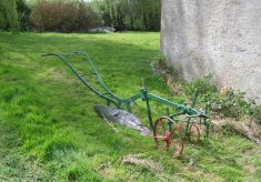 An old plough, on the grass by the Lock House