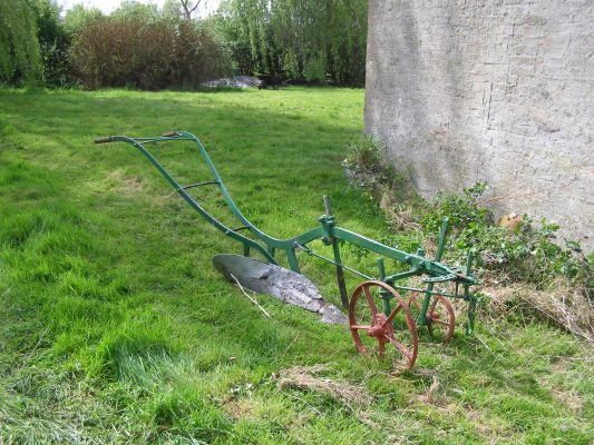 The plough, standing on the grass outside the Lock House cottage. | Neil Fortey
