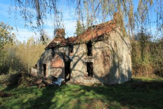 This picture is reproduced from Wikipedia. It was taken after the fire in 2017 when the cottage was badly damaged. Before this, it had been given Listed-Building Class II status, but had suffered vandalism and become delapidated. | Wikemedia commons, photograph by Steven Cobb