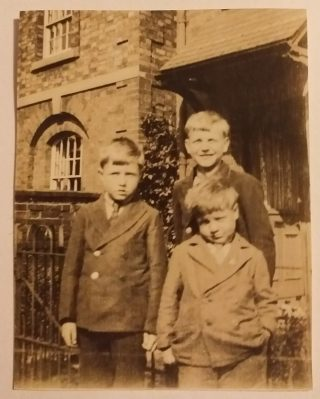 On Queen Street, May 1931, the three Marston boys, Vic (10), Frank (8) and John (about 6). Behind is part of the former Bottesford police station, built in the 1850s, and the first of the terraced cottages next door. | Janet Dammes