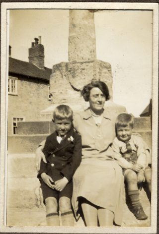 On the steps of Bottesford market cross, Evelyn Marston with sons Vic on her right, and Frank on her left. Mid-1920s. | Janet Dammes