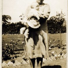 Eve Marston and baby, probably her youngest, Daphne, on a path by a vegatable bed, though the exact location is uncertain.   Janet Dammes