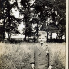 A young lad, possibly Frank Marston (based on comparison with other pictures in this series), in a paddock on the fringe of the village.   Janet Dammes