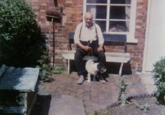 Arthur Marston and his terrier, at home on Queen St, Bottesford