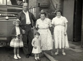 The caption in the photo album:'Janet and Vic Marston, Linda Taylor, Granny [Evelyn Marston] and Daphne Marston, Queen St, Bottesford, 1957 (Vic's lorry).' | Janet Dammes
